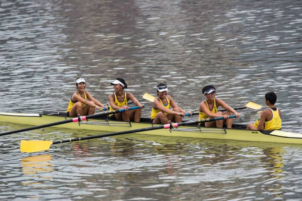 Rowing with her team -- team sports is fun!